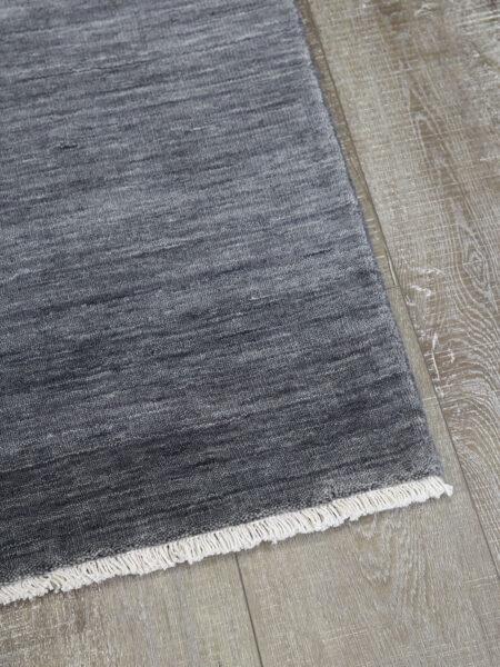 Diva handmade wool rug in Shadow grey - corner image