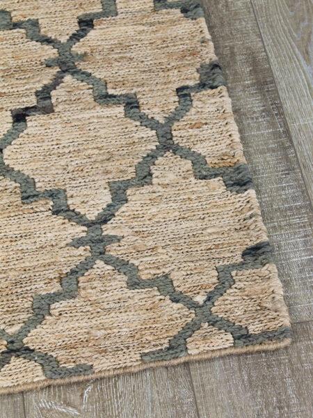 Bengali handwoven jute rug in Natural / Denim - corner image