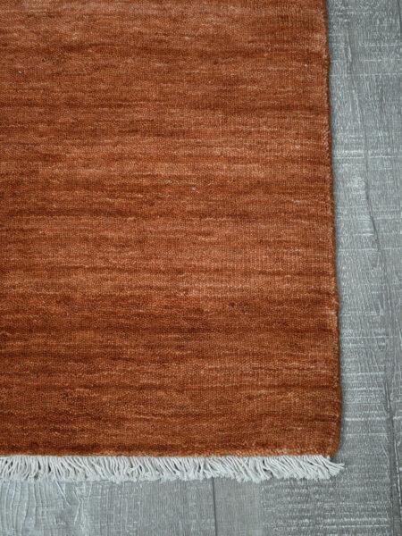Diva handloom knotted wool rug in Ochre - corner image