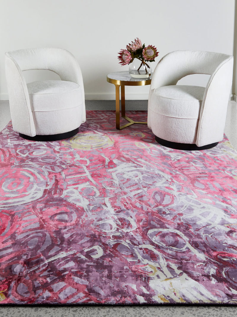 Malangka by Charmaine Pwerle - Indigenours rug design in pink and purple colours - lifestyle image