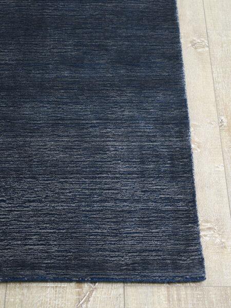 Shimmer Oceanic navy blue rug handmade in wool & artsilk - corner image