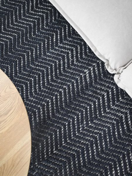 Caspian Charcoal textured chevron design rug handwoven in wool and artsilk - lifestyle image