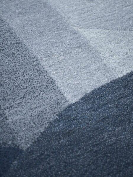 Orbit Windsky handmade rug 100% wool in blue grey tones - close up detail image