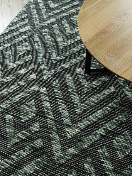 Zamora Forest handwoven flatweave rug in green and black - lifestyle image