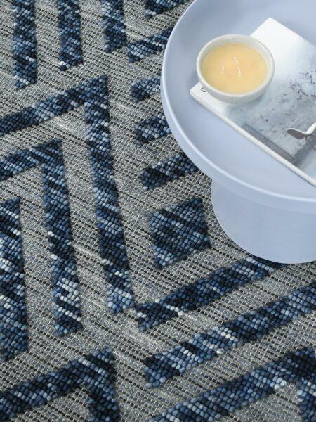 Zamora Indigo handwoven flatweave rug in blue and grey - lifestyle image