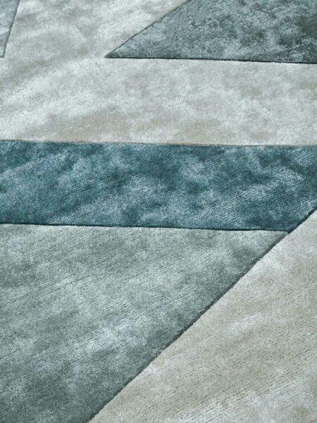 Evolve Marine handtufted artsilk rug with geometric pattern in teal green tones