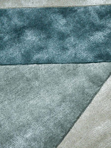 Evolve Marine handtufted artsilk rug with geometric pattern in teal green tones - close up detail image