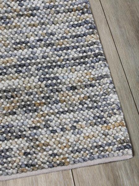 Magic Mineral grey/mustard yellow textured rug handwoven in wool - corner image
